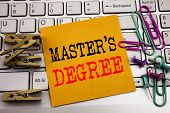 Writing text showing Master s Degree. Business concept for Academic Education written on sticky paper on the white keyboard background. poster