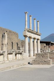 Row Of Marble Columns At Famous Ancient Town Pompeii With Part Of Mount Vesuvius In The Background,