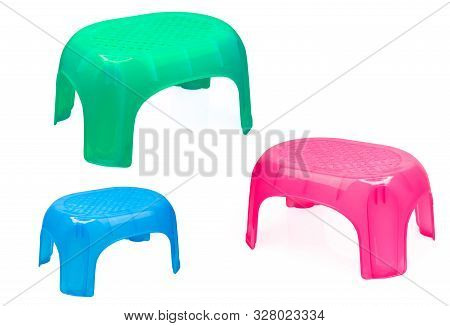 Plastic Stool For Bathroom Or Kitchen. Children Chair. Green, Blue, And Pink Plastic Stool Isolated