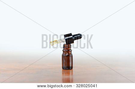 Cbd Oil Glass Bottle On White Background, Cannabis Liquid