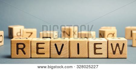 Wooden Blocks With The Word Review. Customer Review Concept. Reviewing, Auditing, Reviewer. Service