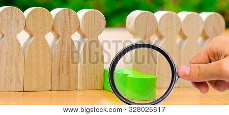 The green figure of a man falls out of the line of people. Concept of employee dismissal and team management in a business company. Weak link. Staff toxicity. Bad worker. Demote. Fired Selective focus poster
