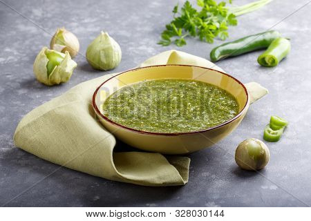 Tomatillo Salsa Verde. Bowl Of Spicy Green Sauce On Gray Table, Mexican Cuisine.