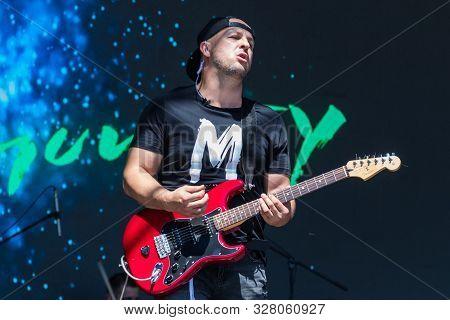 Dnepropetrovsk Region, Ukraine - June 2, 2018: Guitarist  Play Electricity Guitar On Concert Stage O