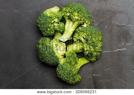 Brocoli On A Black Table In A Top View