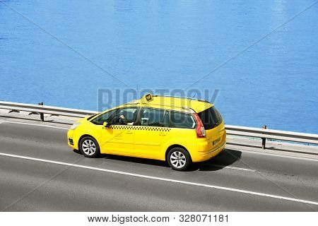 Budapest, Hungary - June 18, 2019: Taxi Cab Driving Along Street Near Danube River