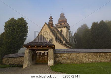 Ancient Gothic Church Of The Presentation Of The Lord  In Morning Fog,  Village Smrečany, Liptov Reg