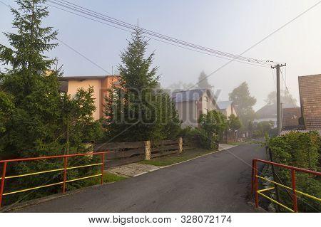 Street Of Ancient Village Smrečany In Fog At The Morning , Liptov Region, Western Tatras, Slovakia.