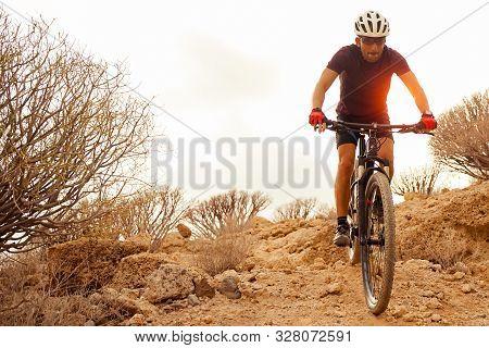 Cyclist In Violet Riding The Mountain Bike On The Spring Enduro Trail. Extreme Sport And Enduro Biki