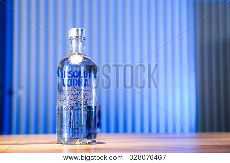 Mykolaiv, Ukraine - September 23, 2019: Bottle Of Absolut Vodka On Wooden Bar Counter. Space For Tex