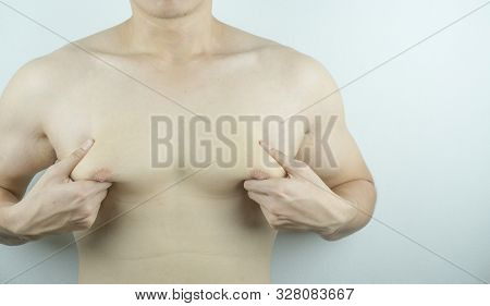 Close Up Man Holding Men Boobs On White Background. Diet, Weight Loss, Slim Body, Healthy Lifestyle