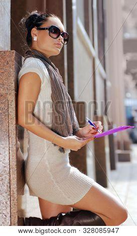 business woman looking away on street