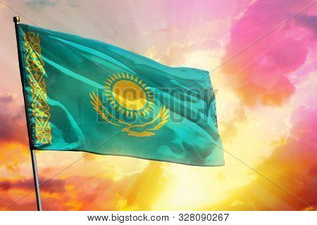 Fluttering Kazakhstan Flag On Beautiful Colorful Sunset Or Sunrise Background. Kazakhstan Success An