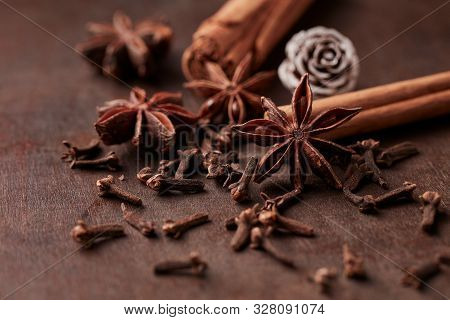 Star Anise, Cinnamon And Dry Spice Cloves. Christmas Spices On Rustic Wooden Background. Close Up.
