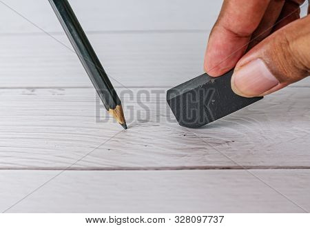 Eraser And Error Concept, Hand With Black Eraser And Pencil On White Table, Mistake Erase Concept