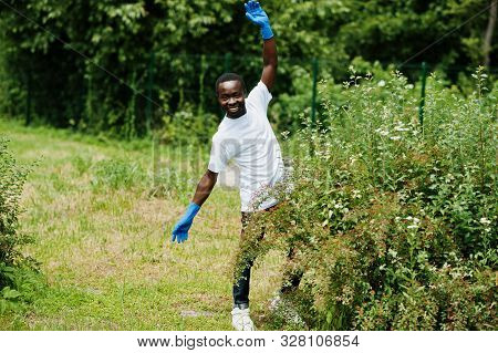 African Volunteer Man In Park. Africa Volunteering, Charity, People And Ecology Concept.
