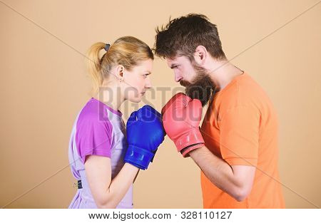 Sportswear. Fight. Knockout And Energy. Couple Training In Boxing Gloves. Happy Woman And Bearded Ma