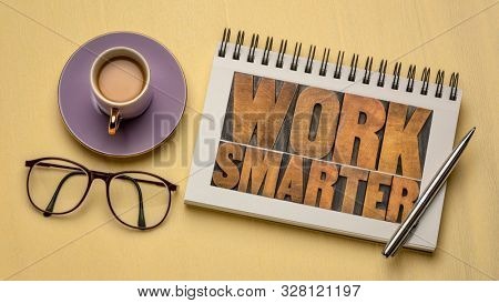 work smarter word abstract - motivational advice or reminder - text in letterpress wood type in a sketchbook with coffee, business productivity and efficiency concept