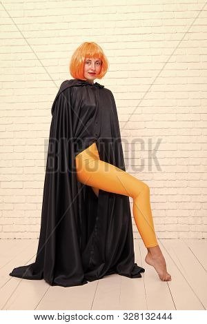 Funky Style Beauty. Sensual Woman In Fashion Style On White Brickwall. Fashion Model Wearing Orange