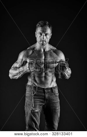 Feeling Athletic And Powerful. Athletic Man Hold Metal Chain In Strong Hands Black Background. Muscu