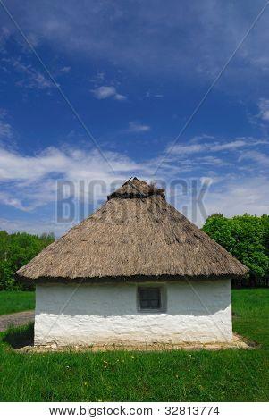 Antient white house with a straw roof, Pirogovo Folk Museum, Kiev, Ukrain