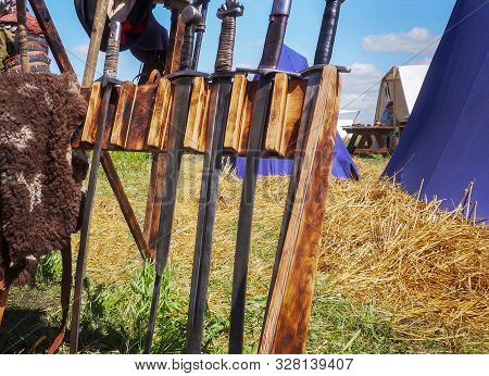 A Large Collection Of Old Medieval Swords.