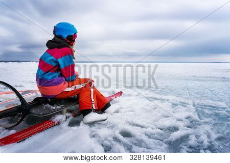 A Young Windsurfer On The Beach Waiting For The Wind.