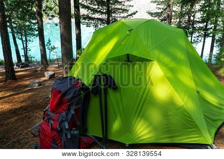 Backpack And Tent In The Woods By The Lake.