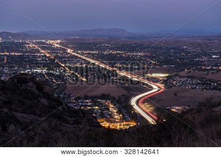 Twilight view of route 118 commuter freeway traffic in suburban Simi Valley near Los Angeles in Ventura County, California.