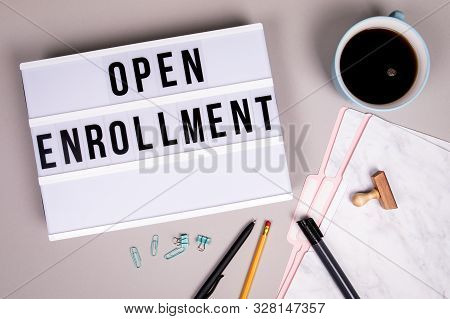 Open Enrollment Concept. White Lightbox On A Grey Desk
