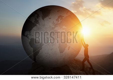 World Business Man Pushing Large Stone Concrete Up To Hill With Reflect Shine Sun Background. Busine