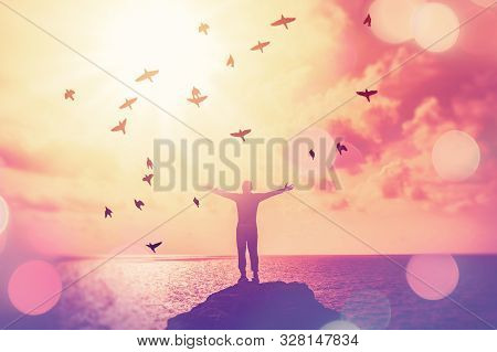 Copy Space Of Man Raise Hand Up On Sunset Sky At Beach And Island Double Exposure Birds Fly Colorful