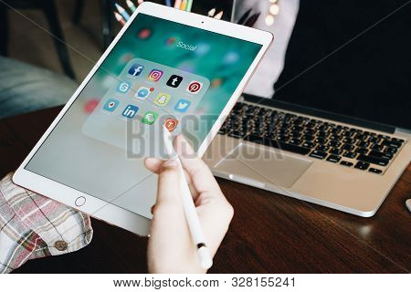 Chiang Mai, Thailand - June 30,2018: Woman Holding Apple Ipad With Icons Of Social Media On Screen.