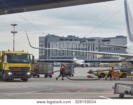 Vnukovo Airport, Moscow - May 2019. Airport Employees Are Refueling The Aircraft With Fuel From Yell