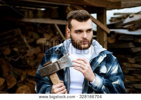 Bearded Lumberjack Checkered Clothes Carry Axe. Sharp Blade. Brutal Man Collects Firewood. Hipster L