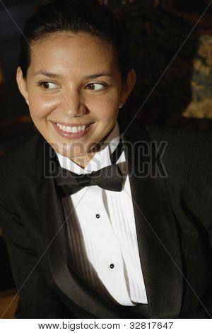 Hispanic female waiter in tuxedo