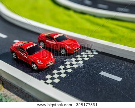 Moscow, Russia - August 8, 2014: Model Of Toy Red Ferrari Sports Car Close Up On The Layout With The