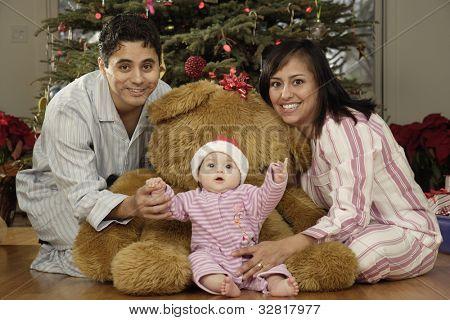 Hispanic parents and baby on Christmas