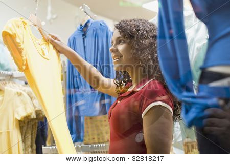 African teenage girl in clothing store
