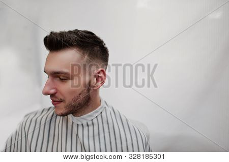 Close Up Head Of Young Bearded Man Getting Haircut At Barbershop. Barber Soul.