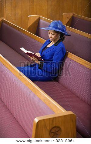 Senior African American woman in church
