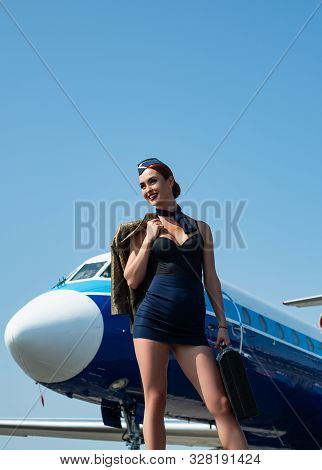 Airline. Business People And Commercial Jetliner. Attractive Young Woman Flight Attendant Stewardess
