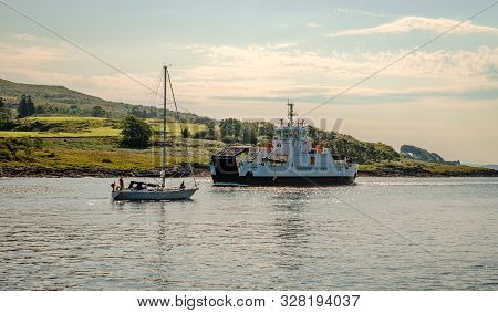 Lochaline / Uk - August 25 2019: A Sailing Boat And A Ferry In Loch Aline. Loch Aline Is A Small Sal
