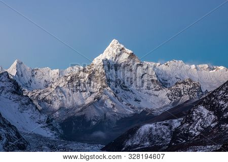 Mountain Ama Dablam Summit On The Everest Base Camp Trek In Himalayas, Nepal. Curious Photo.