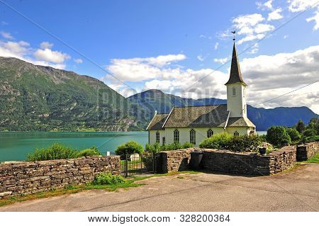 White Wooden Chapel At The Lake On Fjords