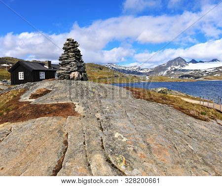 Stone Pyramid In Mountains At The Lake