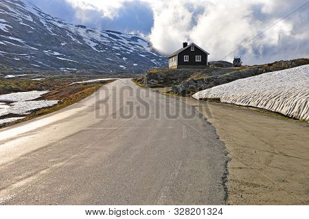 Scenic View Of Snow Road With Clouds