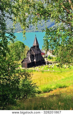 Vertical Image Of Ornes Stave Church On Fjords