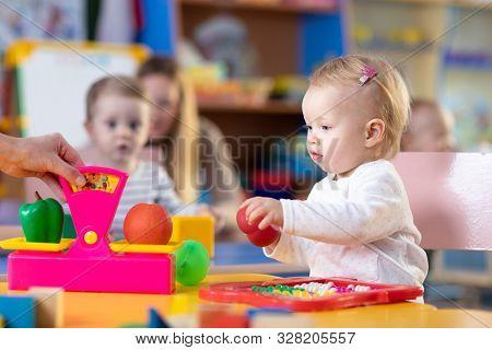 Little Children Playing In Nursery Or Creche