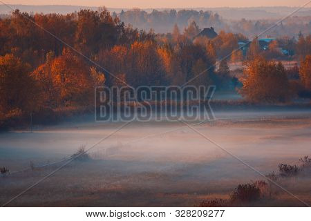 Scenic Autumn Landscape At Sunrise. Aerial View On Countryside. Colorful Mistery Autumn Background.